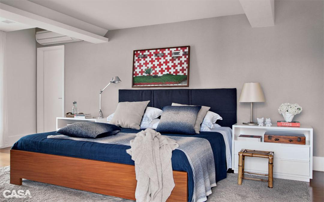 quarto clean com azul escuro